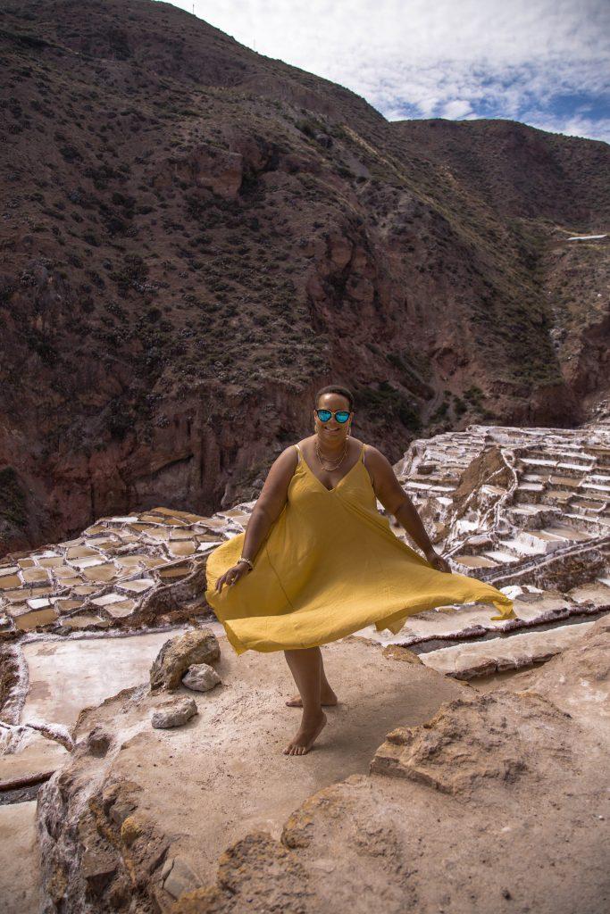 Lady in yellow dress at Peru salt flats